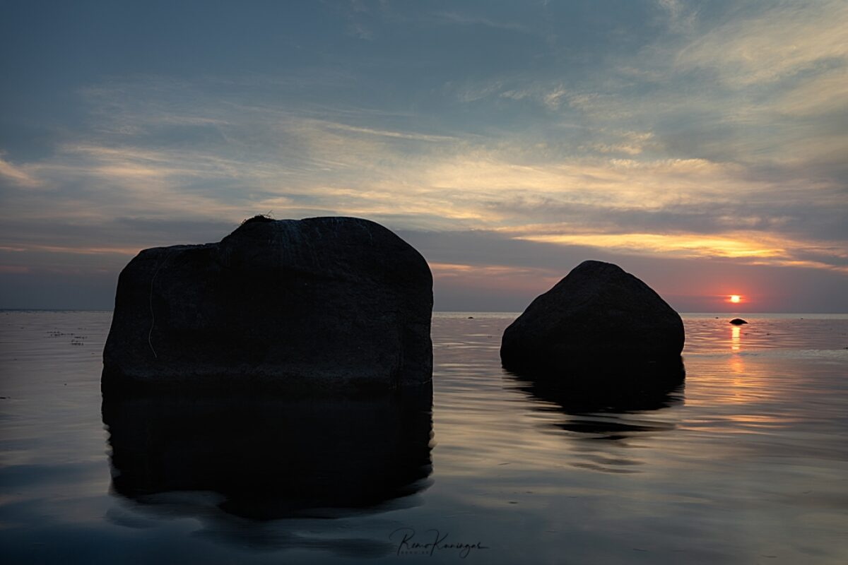 Sun setting behind erratic boulders